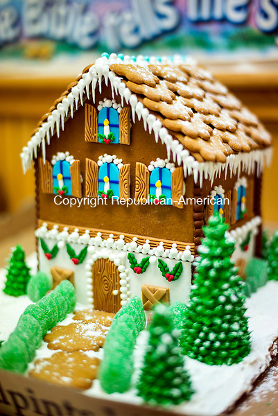 """Middlebury, CT- 25 November 2016-112516CM04-  A """"Swiss chalet"""" made of gingerbread and constructed by Beverly Dassonville  of Middlebury, is shown at St. George's Episcopal Church in Middlebury on Friday.  Volunteers were getting the houses ready for the annual gingerbread village, which opens on December 3rd.     Christopher Massa Republican-American"""