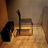 A security guard's chair, by the entrance to the session hall at the European Parliament, waits for an occupant prior to the arrival of thousands of the parliament's employees who travel between the three sites of government in Brussels, Strasbourg and Luxembourg.