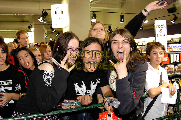 FANS.BULLET FOR MY VALENTINE.Signing session at HMV Oxford Circus, London..October 4th, 2005.half length hand gesture tongue.www.capitalpictures.com.sales@capitalpictures.com.©Capital Pictures