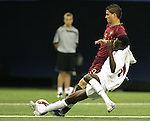 08 July 2007: Gambia's Ebrima Sohna (front) challenges Portugal's Zequinha (9) for the ball. Gambia's Under-20 Men's National Team defeated Portugal's Under-20 Men's National Team 2-1 in a Group C opening round match at Olympix Stadium in Montreal, Quebec, Canada during the FIFA U-20 World Cup Canada 2007 tournament.