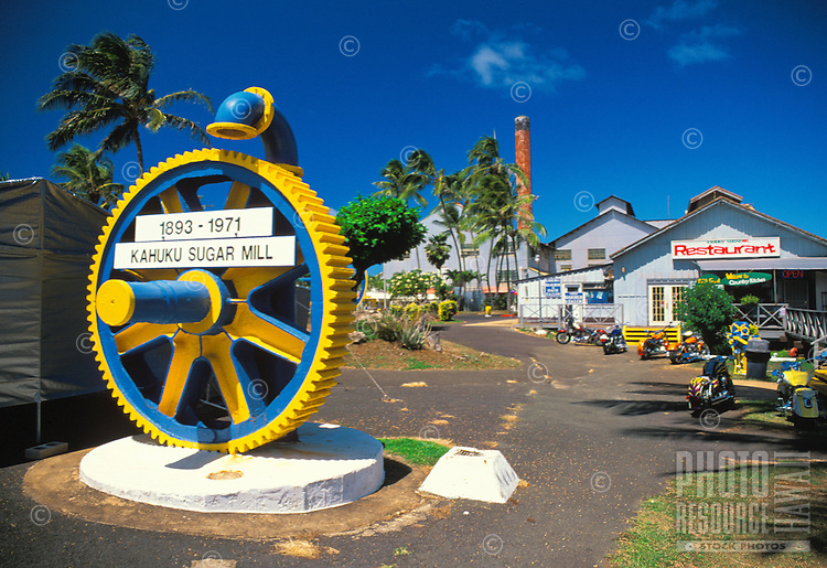 The Kahuku Sugar Mill shopping center. Located in the town of Kahuku, this center was once a productive sugar mill. It has been transformed into a shopping area with a restaurant and museum located within the old historic sugar mill.