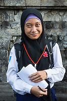 Borobudur, Java, Indonesia.  Teenage Indonesian Student from Surabaya Visiting the Temple.