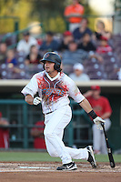 Joe Weik #15 of the Inland Empire 66ers, wearing a Zombie Apocalypse Night jersey, bats against the Visalia Rawhide at San Manuel Stadium on June 12, 2014 in San Bernardino, California. Inland Empire defeated Visalia, 4-2. (Larry Goren/Four Seam Images)