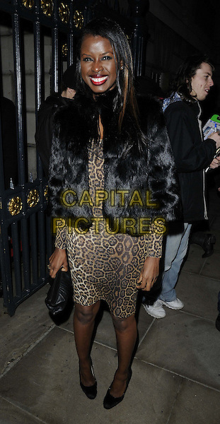 June Sarpong.The Place For Peace fundraising gala, Banqueting House, Whitehall, London, England..November 10th, 2012.full length black dress fur jacket brown leopard print .CAP/CAN.©Can Nguyen/Capital Pictures.