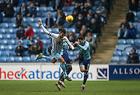 Joe Jacobson of Wycombe Wanderers clears from Marcus Tudgay of Coventry City during the The Checkatrade Trophy - EFL Trophy Semi Final match between Coventry City and Wycombe Wanderers at the Ricoh Arena, Coventry, England on 7 February 2017. Photo by Andy Rowland.