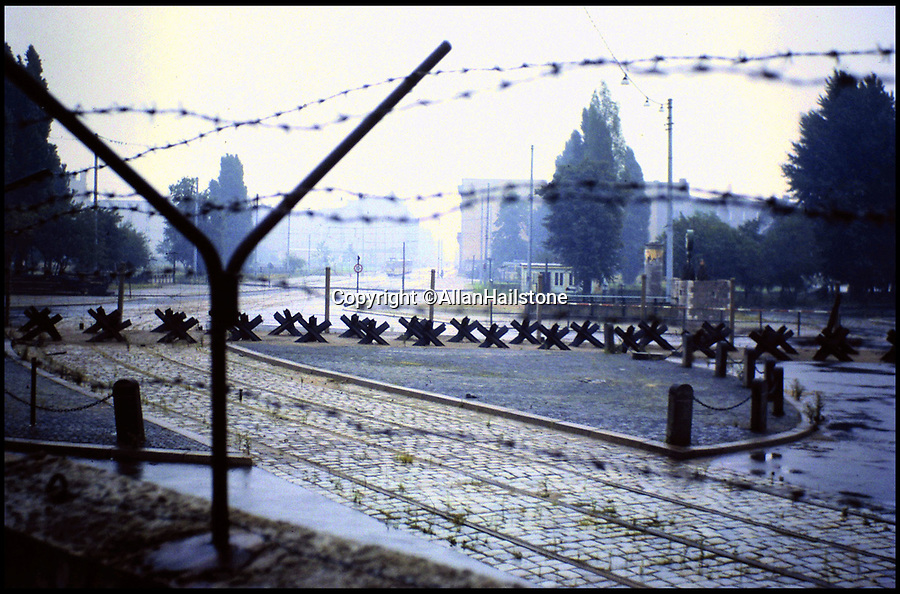 BNPS.co.uk (01202 558833)<br /> Pic: AllanHailstone/BNPS<br /> <br /> Looking into East Berlin over the wall from Potsdamer Platz.<br /> <br /> New book reveals unseen pictures of the bleak landscape of Cold War Berlin.<br /> <br /> The remarkable photos were taken by a British visitor before and after the Berlin Wall was built in 1961.<br /> <br /> Retired coin dealer Allan Hailstone visited Berlin several times between 1959 and 1966 and took hundreds of photos of both West Berlin and East Berlin.<br /> <br /> The 78 year old was struck by the stark contrast between the vibrant, colourful West Berlin he encountered and rubble-filled, sparse East Berlin.<br /> <br /> During his first visit to Berlin in 1959, Mr Hailstone was able to walk freely between the two sides of the city, but this changed when he returned in 1962 as the Berlin Wall had been built to stop east Berliners from escaping to the west.