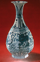 China:  Blue and white octagonal bottle with dragon and cloud design.  Yuan (Mongol)  Dynasty 1271-1368 A.D.
