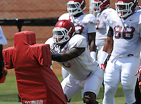 NWA Democrat-Gazette/ANDY SHUPE<br /> Arkansas defensive lineman JaMichael Winston participates in a drill Saturday, Aug. 8, 2015. during practice at the university football practice field in Fayetteville.