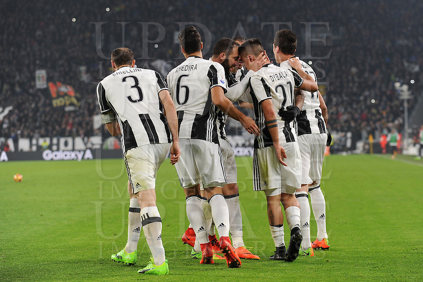Calcio, semifinale di andata di Tim Cup: Juventus vs Napoli. Torino, Juventus Stadium, 28 febbraio 2017.<br /> Juventus' Paulo Dybala, second from right, celebrates with teammates after scoring on a penalty kick during the Italian Cup semifinal first leg football match between Juventus and Napoli at Turin's Juventus stadium, 28 February 2017.<br /> UPDATE IMAGES PRESS/Manuela Viganti