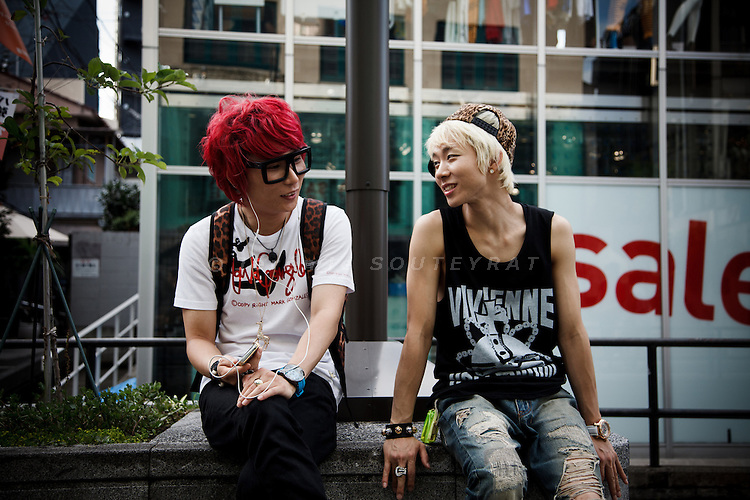 Tokyo, July 2012 - Fashionable friends talking on Cat street in the Harajuku area