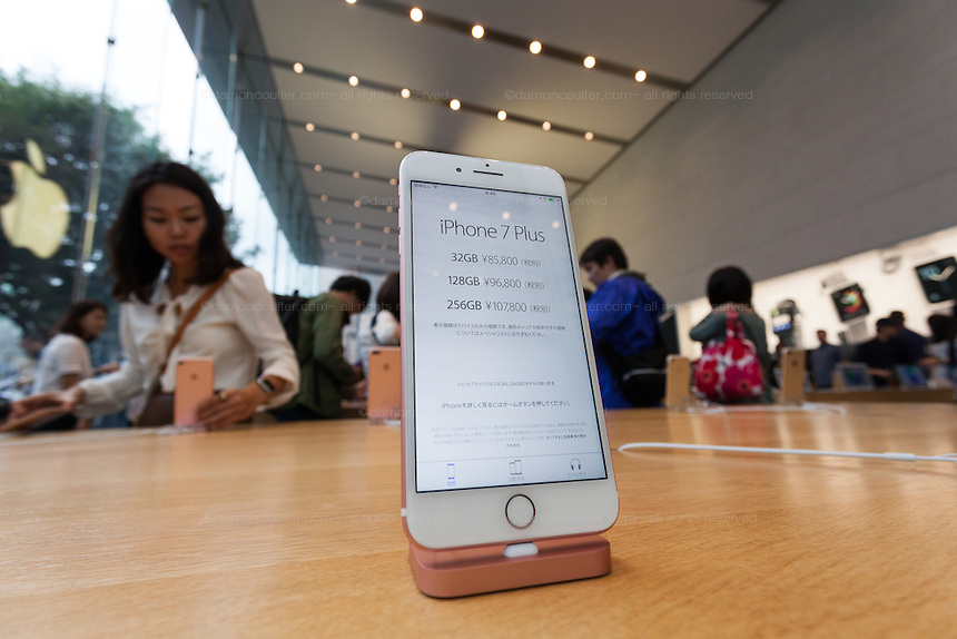 The screen of the new iPhone 7s and iPhone 7 plus , showing the prices of the different models in japanese Yen, on display in the Apple store  in Omotesando, Tokyo, Japan. Friday September 16th 2016. The iPhone launches are global events. Around 200 eager customers waited outside the Apple store in Tokyo, some for several days, to be first in line to buy the new product.
