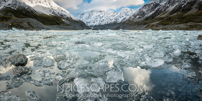 Icebergs and ice debris on Hooker Lake with Aoraki Mount Cook partly in clouds, Aoraki Mtount Cook National Park, Mackenzie Country, World Heritage Area, New Zealand