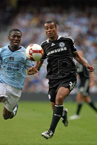 13 September 2008: Chelsea defender Ashley Cole competes for the ball with Shaun Wright-Phillips during the Premier League game between Man City and Chelsea, played at The City of Manchester Stadium. Chelsea won the game 3-1 Photo: Action Plus..080913 soccer football player