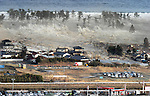 Massive 8.9-magnitude earthquake hits Japan. Massive Tsunami triggered by a huge earthquake in northeastern Japan, Saturday, March 11, 2011. Miyagi Natori PM3:55 photo:Mainichi/Nippon News