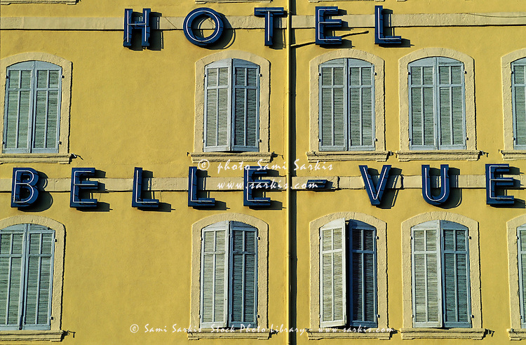 Hotel facade with all its shutters closed, Marseille, France.