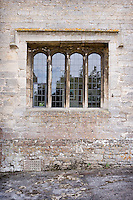 An elegant stone-framed mullion window is a feature of the manor house