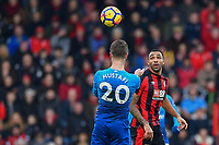 Shkodran Mustafi of Arsenal heads the ball as Callum Wilson of AFC Bournemouth looks on during AFC Bournemouth vs Arsenal, Premier League Football at the Vitality Stadium on 14th January 2018