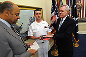 In this photo released by the United States Department of Defense, the Honorable Ray Mabus, right, is sworn in as the 75th Secretary of the Navy Tuesday, May 19, 2009 by Jeh Johnson, General Counsel for the Department of Defense a ceremony at the Pentagon in Washington, DC. Holding the Bible for Nabus is Yeoman 1st Class Timothy James, a member of the Secretary of the Navy staff. <br /> Mandatory Credit: Kevin S. O'Brien/DoD via CNP