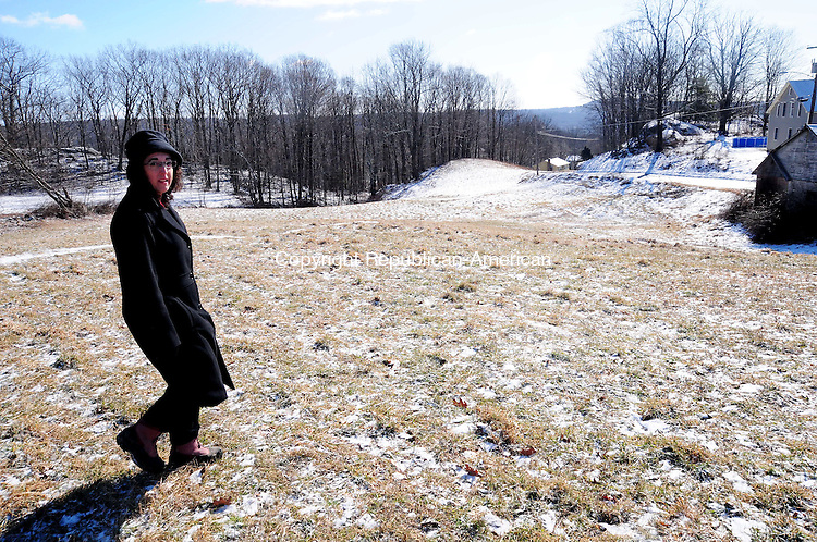 THOMASTON, CT, 26 JAN 13-012613AJ02-  Lissa Jennings, who owns 15.8 acres off Fenn Road which has been in her family for two centuries,  walks across a field now used for hay on Saturday. Alec Johnson/ Republican-American