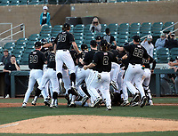 The Cal Poly Mustangs celebrate after defeating Vanderbilt, 9-8, in the last game of the MLB4 college tournament at Salt River Fields on February 16, 2020 in Scottsdale, Arizona (Bill Mitchell)
