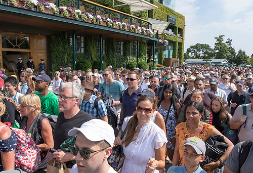 July 6th 2017, All England Lawn Tennis and Croquet Club, London, England; The Wimbledon Tennis Championships, Day 4; The general public walking in to Wimbledon once the entrances were opened for today