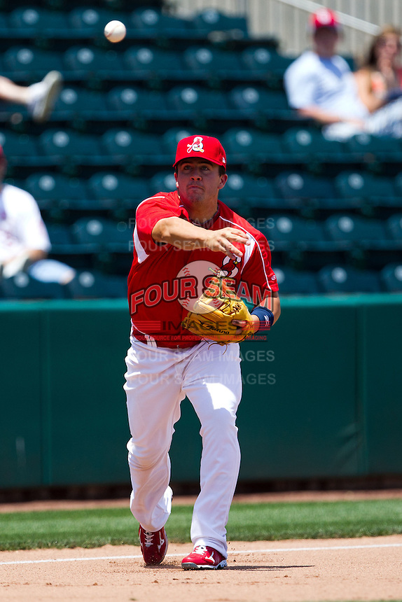 Zack Cox (7) of the Springfield Cardinals throws to first base during a game against the San Antonio Missions on May 30, 2011 at Hammons Field in Springfield, Missouri.  Photo By David Welker/Four Seam Images