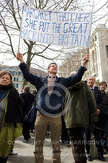 Male supporter of Margaret Thatcher with banner 'Margaret Thatcher put the Great into Britain,' outside St Paul's Cathedral following the funeral of Margaret Thatcher, London, 17 April 2013.<br /> <br /> Margaret Thatcher (1925-2013) was a radical Conservative politician and British Prime Minister from 1979 to 1992.  <br /> <br /> PHOTO COPYRIGHT GRAHAM HARRISON graham@grahamharrison.com<br /> +44 (0) 7974 357 117<br /> Moral rights asserted.
