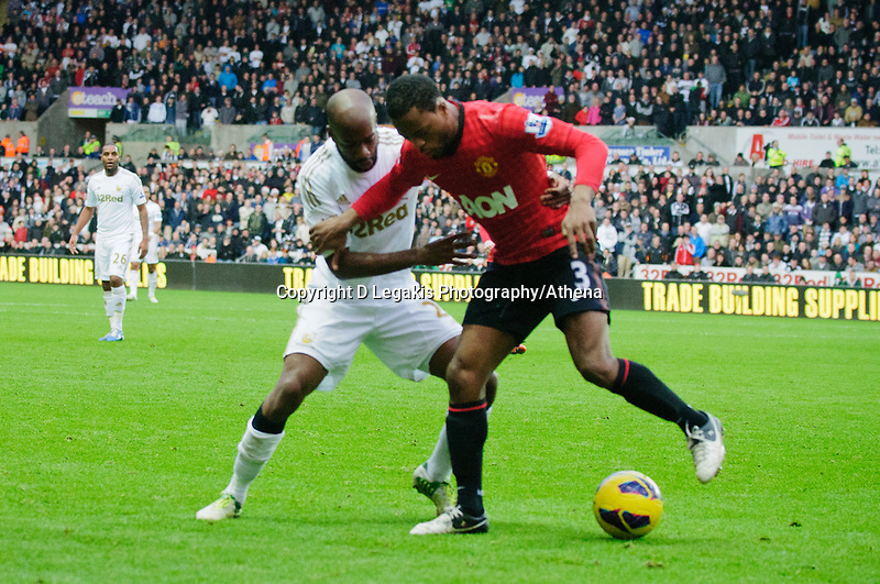 Sunday, 23 November 2012<br /> <br /> Pictured: Kemmy Augustien of Swansea City,Dwight Tiendalli of Swansea City and Patrice Evra (vice-captain) of Manchester United<br /> <br /> Re: Barclays Premier League, Swansea City FC v Manchester United at the Liberty Stadium, south Wales.