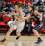 RAPID CITY, S.D. -- DECEMBER 7, 2013 -- Madeleine White #5 of the University of South Dakota drives around Renae Walters #42 of South Dakota Mines during their game Saturday at the Rushmore Plaza Civic Center Ice arena in Rapid City, S.D.  (Photo by Dick Carlson/Inertia)