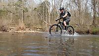 NWA Democrat-Gazette/FLIP PUTTHOFF <br /> Richard Cook of Springdale pedals across Lee Creek April 6 2019 during a group ride at the 31st annual Ozark Mountain Bike Festival at Devil's Den State Park.
