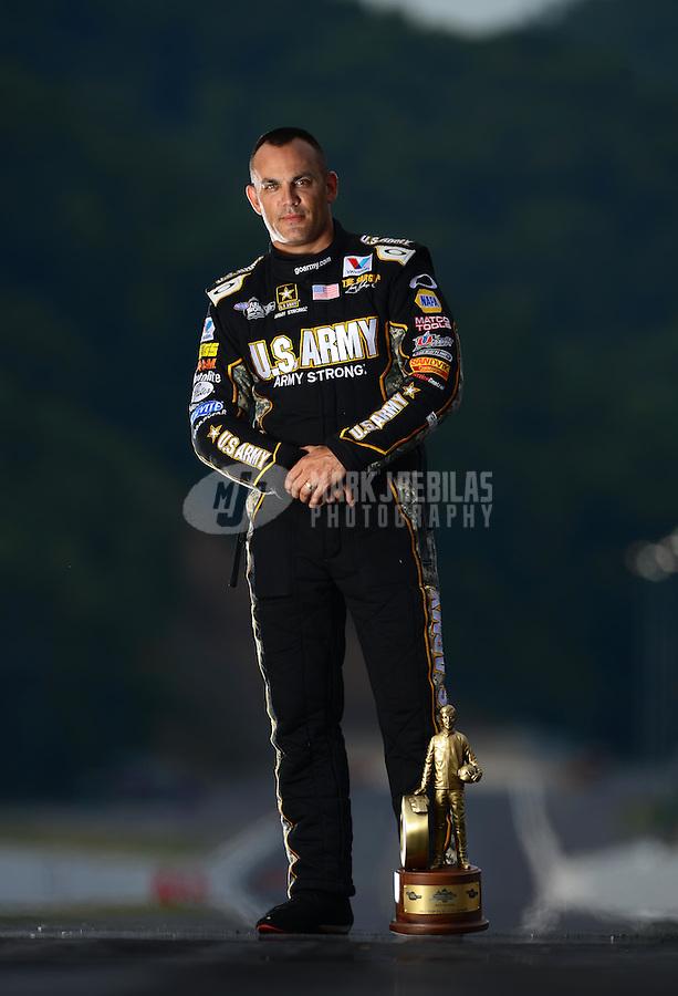 Jun. 17, 2012; Bristol, TN, USA: NHRA top fuel dragster driver Tony Schumacher poses for a portrait after winning the Thunder Valley Nationals at Bristol Dragway. Mandatory Credit: Mark J. Rebilas-