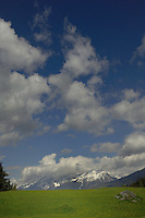 White clouds, blue sky and mountains. Imst area Austria.The Alps