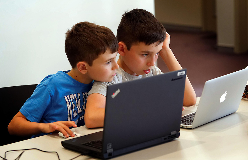 CoderDoJo, a volunteer led coding club for kids where they learn to code. Brothers Riley (9) and Tristan (12) Nel of Applecross. photo by Trevor Collens 8/12/2016