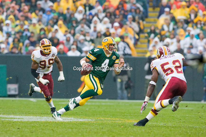 Quarterback Brett Favre #4 of the Green Bay Packers scrambles for yardage during an NFL football game against the Washington Redskins on October 14, 2007 in Green Bay, Wisconsin. The Packers beat the Redskins 17-14. (Photo by David Stluka)