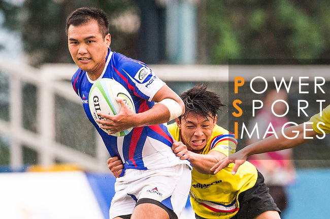 Hsin–Hung Chiang of Chinese Taipei battles for the ball during the match between Chinese Taipei and Thailand of the Asia Rugby U20 Sevens Series 2016 on 12 August 2016 at the King's Park, in Hong Kong, China. Photo by Marcio Machado / Power Sport Images