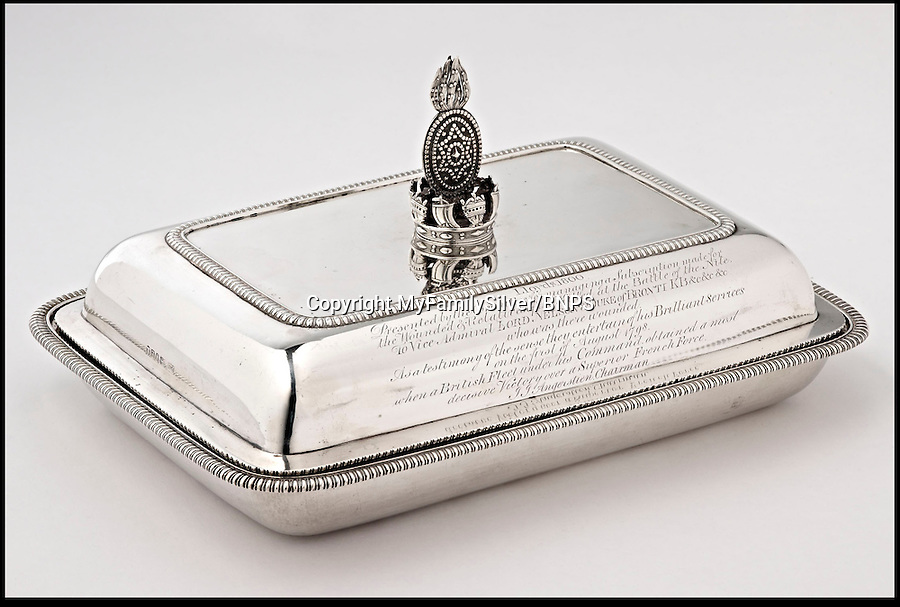 BNPS.co.uk (01202 558833)<br /> Pic: MyFamilySilver/BNPS<br /> <br /> ***Please use full byline***<br /> <br /> The most sought after piece of silver that was ever awarded to Lord Nelson has finally come to light after 122 years and is set to sell for £400,000. The entree dish was purchased for Nelson as part of a collection to reward him for his victory at the Battle of the Nile in 1798. <br /> What was then known as Lloyd's Coffee House but later became Lloyd's of London, gave him a £500 reward to spend which is the equivalent of £50,000 today. Nelson ordered a 22 piece silver service and had it custom designed with his heraldic crest, which was then sent to him while he was at sea. Three of the four rectangular dishes are on display in museums but the fourth was passed down through family and has not been seen in public since an exhibition in 1891.