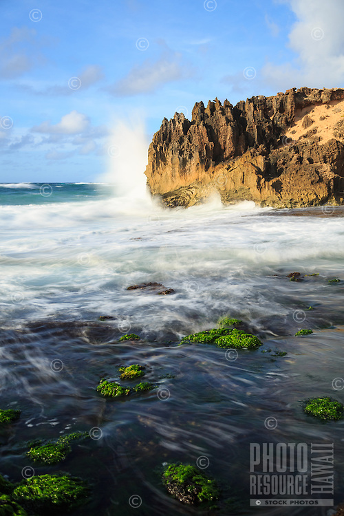 At sunrise, powerful waves crash against the pinnacles along Maha'ulepu Heritage Trail, southern Kaua'i.