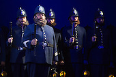 """London, UK. 7 May 2015. At the centre Jonathan Lemalu as Police Sergeant. Dress rehearsal of the Gilbert and Sullivan comic opera """"The Pirates of Penzance"""" at the London Coliseum. Award winning director Mike Leigh makes his operatic directing debut with The Pirates of Penzance. The ENO production opens at the London Coliseum on 9 May 2015 and runs for 14 productions until 27 June 2015. The English National Opera production is conducted by David Parry. Cast: Andrew Shore as Major-General Stanley, Joshua Bloom as The Pirate King, Alexander Robin Baker as Samuel, Robert Murray as Frederic, the Pirate Apprentice, Jonathan Lemalu as Sergeant of the Police, Claudia Boyle as Mabel, Soraya Mafi as Edith, Angharad Lyddon as Kate, Lydia Marchione as Isabel and Rebecca de Pont Davies as Ruth. Photo: Bettina Strenske"""