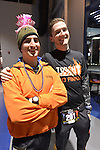 "East Meadow, New York, USA. December 31, 2014. L-R, JUSTIN KUPINSKI, weariing a pink ""Happy New Year"" paper pink tiara, and from Waterford NY, and BEN TURNER of Babylon, are runners who will participate in a 5K New Year's Eve DASH to support the Long Island Council on Alcoholism and Drug Dependence (LICADD) at the Twin RInks Ice Center at Eisenhower Park in Long Island. A Skatin' New Year's Eve event started hours earlier and a New Year's Eve Party, open to runners, family and friends continued until 2:30 a.m."
