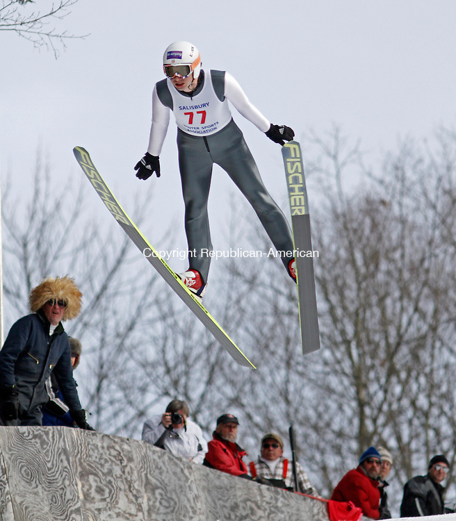 Salisbury, CT-020814MK03 Spencer Kinickerbocker soars down the hill  as volunteers look on during The Salisbury Invitational Competition on Saturday afternoon at Satre Hill in Salisbury.  Tyler Smith won the event with an overall score of 222.2. The Eastern U.S. Ski Jumping Championships begin today at 1 p.m.   Michael Kabelka / Republican-American