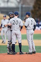 Georgetown Hoyas catcher Eric Webber (21) has a chat on the mound with starting pitcher Kevin Superko (20) and second baseman Chase Bushor (2) during the game against the Bucknell Bison at Wake Forest Baseball Park on February 14, 2015 in Winston-Salem, North Carolina.  The Hoyas defeated the Bison 8-5.  (Brian Westerholt/Four Seam Images)