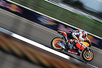 Repsol Honda's Casey Stoner on his way to winning the 2011 Red Bull Indianapolis Moto Grand Prix at Indianapolis Motor Speedway.