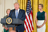United States President Donald J. Trump makes remarks at an event with small businesses in the East Room of the White House in Washington, DC on Tuesday, August 1, 2017.  Looking on from left is Administrator of the Small Business Administration (SBA) Linda McMahon and from the right is Ivanka Trump.<br /> Credit: Ron Sachs / CNP