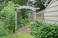 Garden entrance entry, trellis arbor, house, side of house leading to backyard