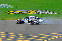 Jimmie Johnson (#48) heads to the pits after hitting the wall.