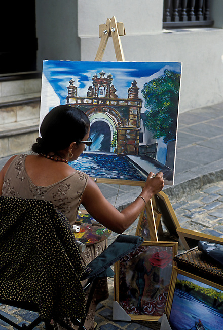 Painter along Calle del Cristo, Old San Juan, San Juan, Puerto Rico, West Indies
