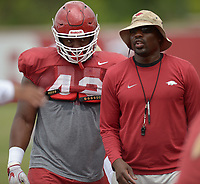 NWA Democrat-Gazette/ANDY SHUPE<br /> Arkansas assistant coach John Scott Jr. speaks alongside defensive lineman Jonathan Marshall during a drill Tuesday, Aug. 7, 2018, during practice at the university practice fields in Fayetteville. Visit nwadg.com/photos to see more photographs from the practice.