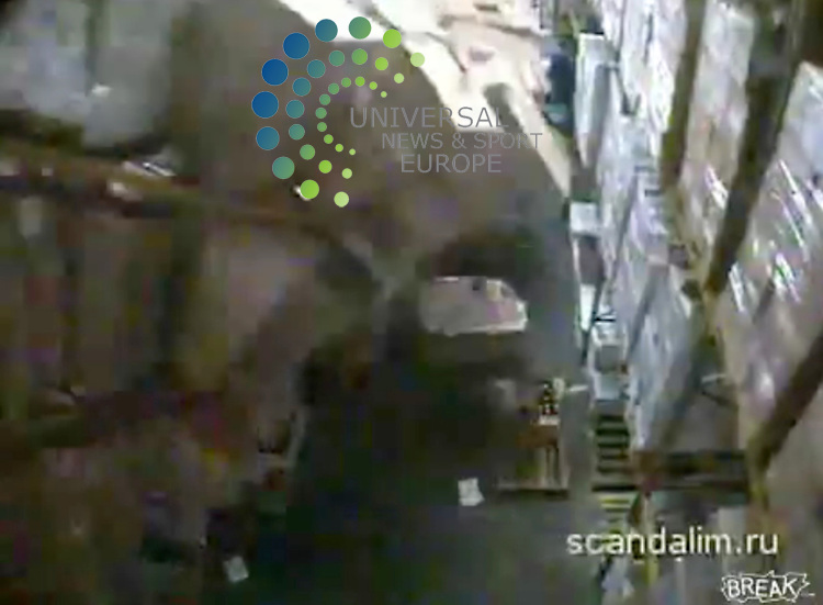 Video footage - in a sequence of five pix -  of a forklift driver accidentally destroying £189,000 worth of alcohol in a Russian warehouse has been posted on the internet. Taken from a CCTV camera in the warehouse, the video shows the driver reversing into a stack of boxes, containing bottles of vodka and cognac.  The collision caused a domino effect that left him and another forklift driver buried under hundreds of boxes. Colleagues of the driver are seen frantically climbing over the boxes to rescue the drivers buried underneath.  One of the drivers suffered a minor foot injury while the other escaped unharmed. The video was sent to a Russian website by an anonymous worker at the warehouse. . Picture  3 November  2009:  Universal News and Sport (Scotland)..All pictures must be credited to  www.universalnewsandsport.com.(0ffice) 0844 884 51 22.