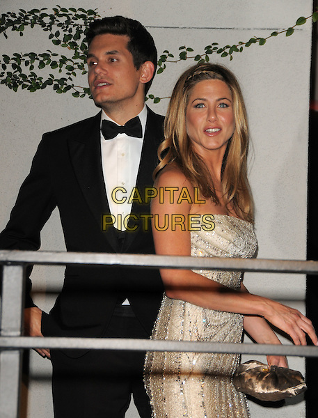JOHN MAYER & JENNIFER ANISTON.The 2009 Vanity Fair Oscar Party held at The Sunset Tower Hotel in West Hollywood, California, USA..February 22nd, 2009.oscars half length white silver beads beaded strapless dress jewel encrusted black tuxedo couple clutch bag .CAP/DVS.©Debbie VanStory/Capital Pictures.