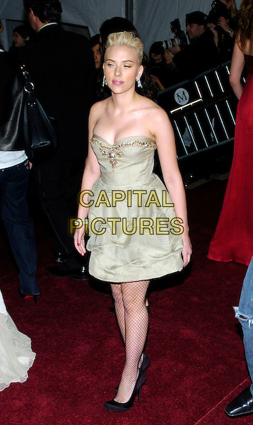 "SCARLETT JOHANSSON.2007 Metropolitan Museum of Art Costume Institute Gala celebrating ""Poiret: King of Fashion"" exibition at the Metropolitan Museum of Art, New York City, New York, USA..May 7th, 2007.full length beige strapless dress black shoes fishnet stockings tights gold trim.CAP/ADM/BL.©Bill Lyons/AdMedia/Capital Pictures *** Local Caption ***"